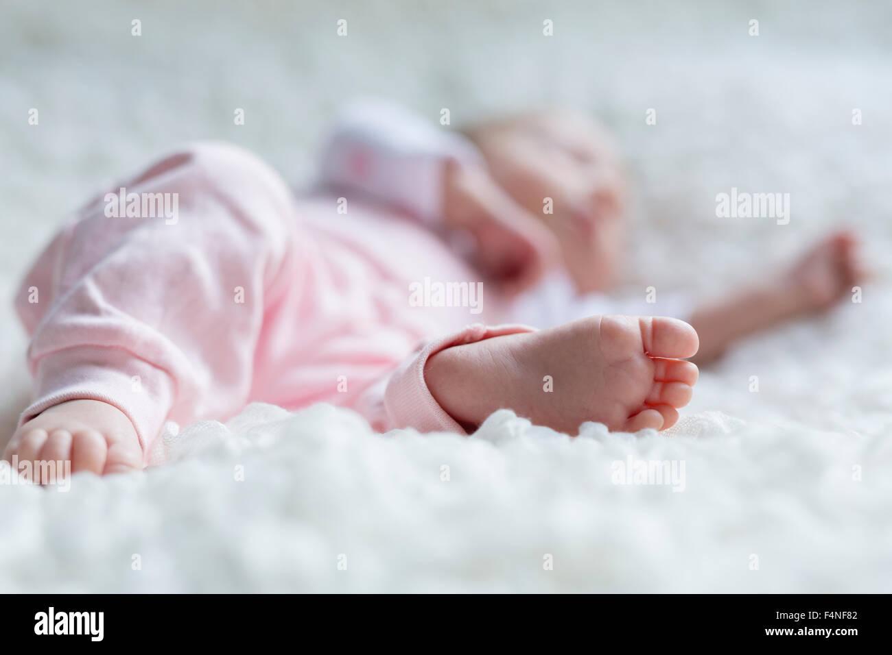 Foot of newborn baby girl - Stock Image