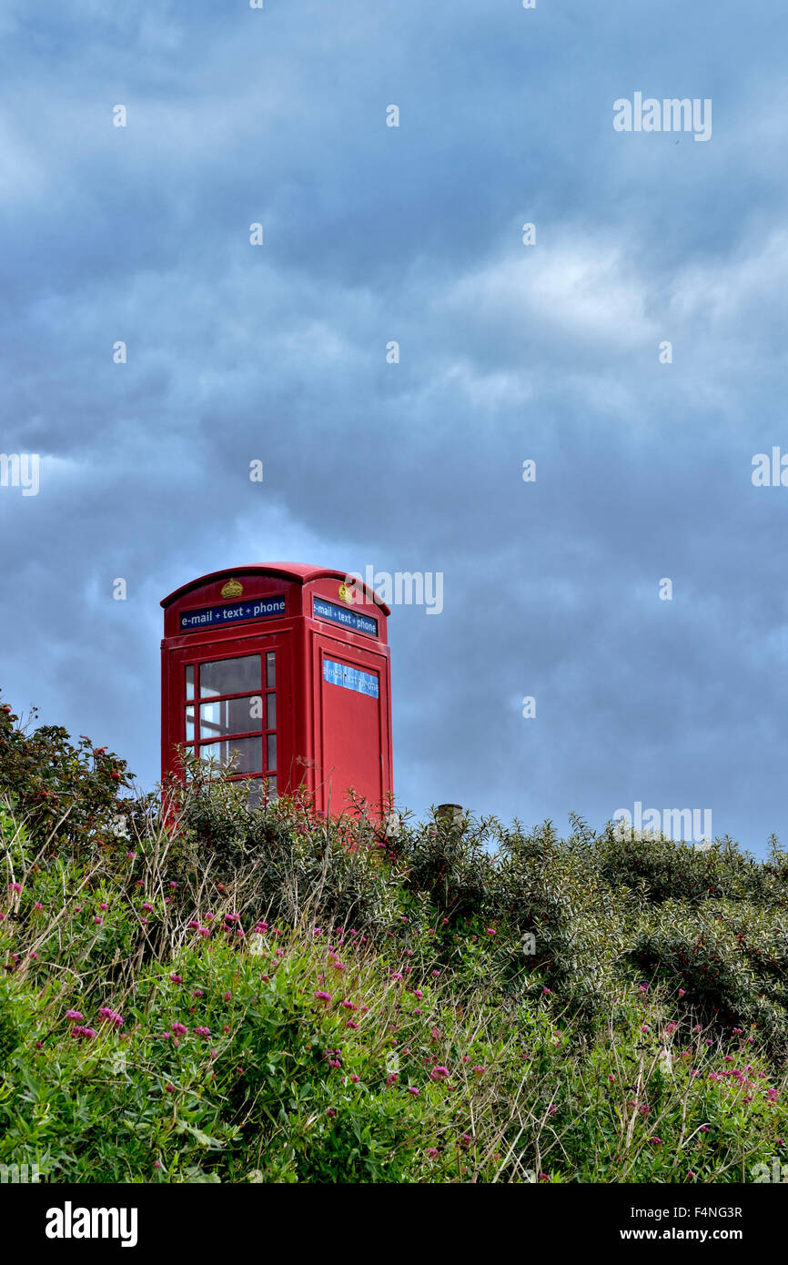 Old red telephone box in South Devon, taken near Challaborough, UK - Stock Image