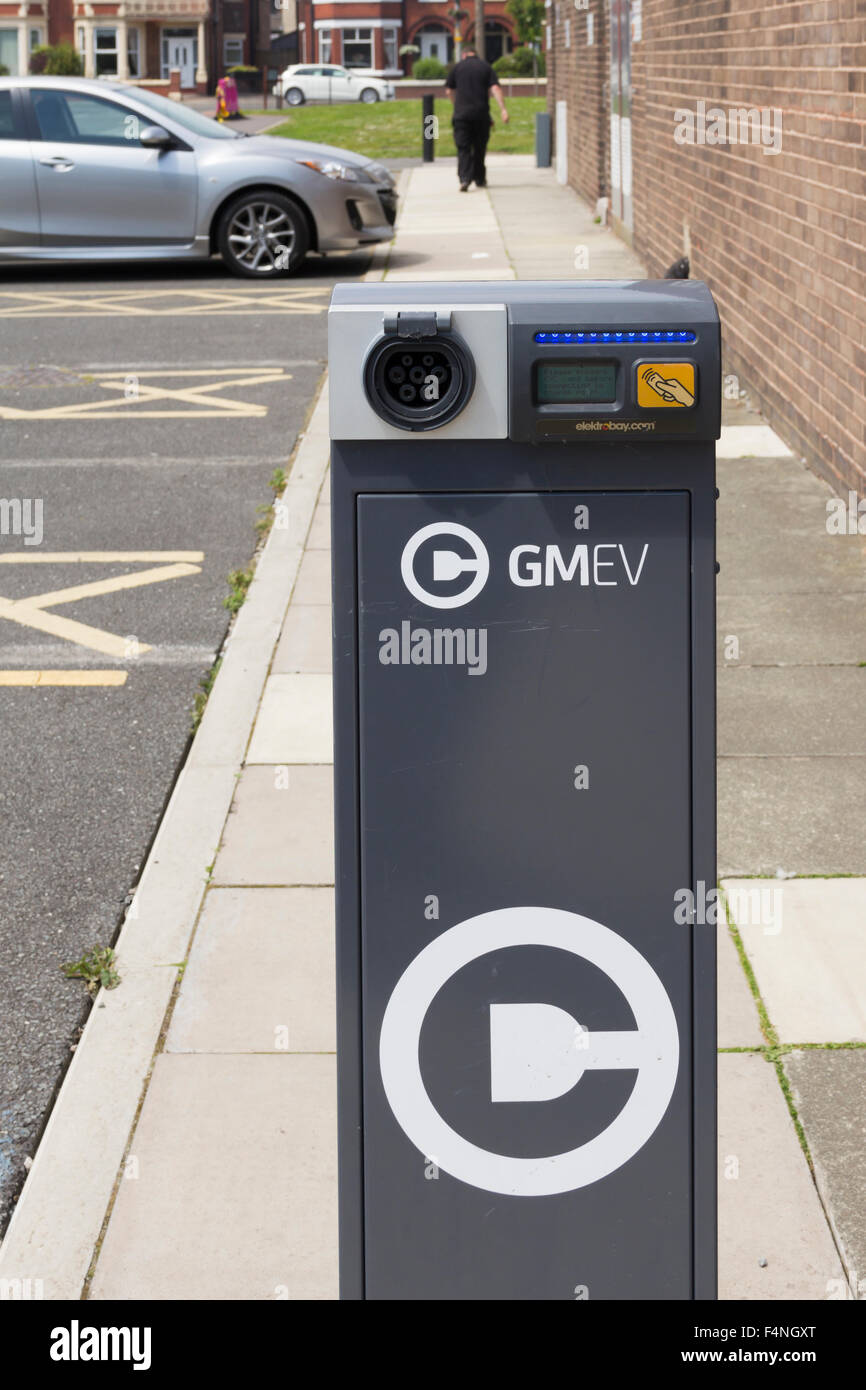 Electric car charging point at Irlam and Cadishead Lesiure Centre, Salford, Greater Manchester, operated by GMEV. - Stock Image