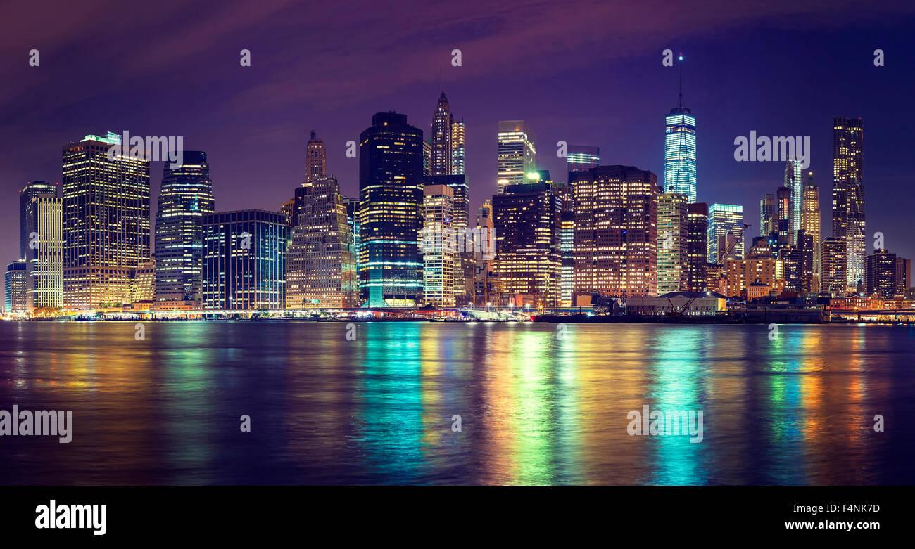 Vintage toned Manhattan skyline at night, NYC, USA. Stock Photo
