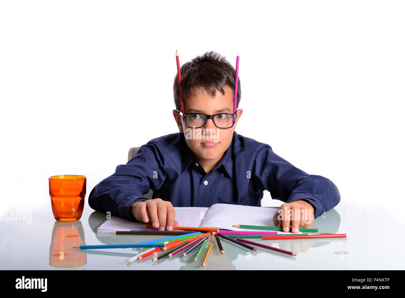 At home it's time to do homework. The student has a good idea for his work. - Stock Image