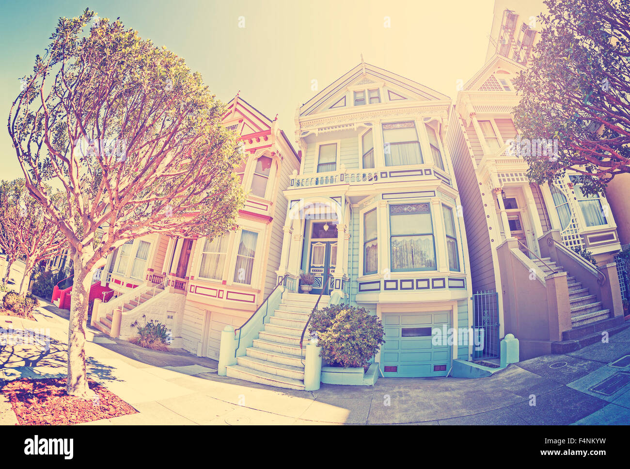 Vintage stylized fisheye lens street photo of the Painted Ladies, San Francisco, USA. - Stock Image