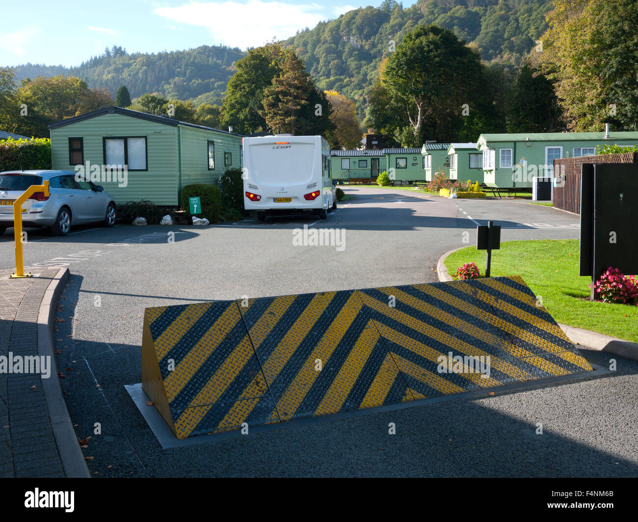Motorhome just going through Security Barrier at campsite at Betws-y-coed, North Wales, UK. - Stock Image
