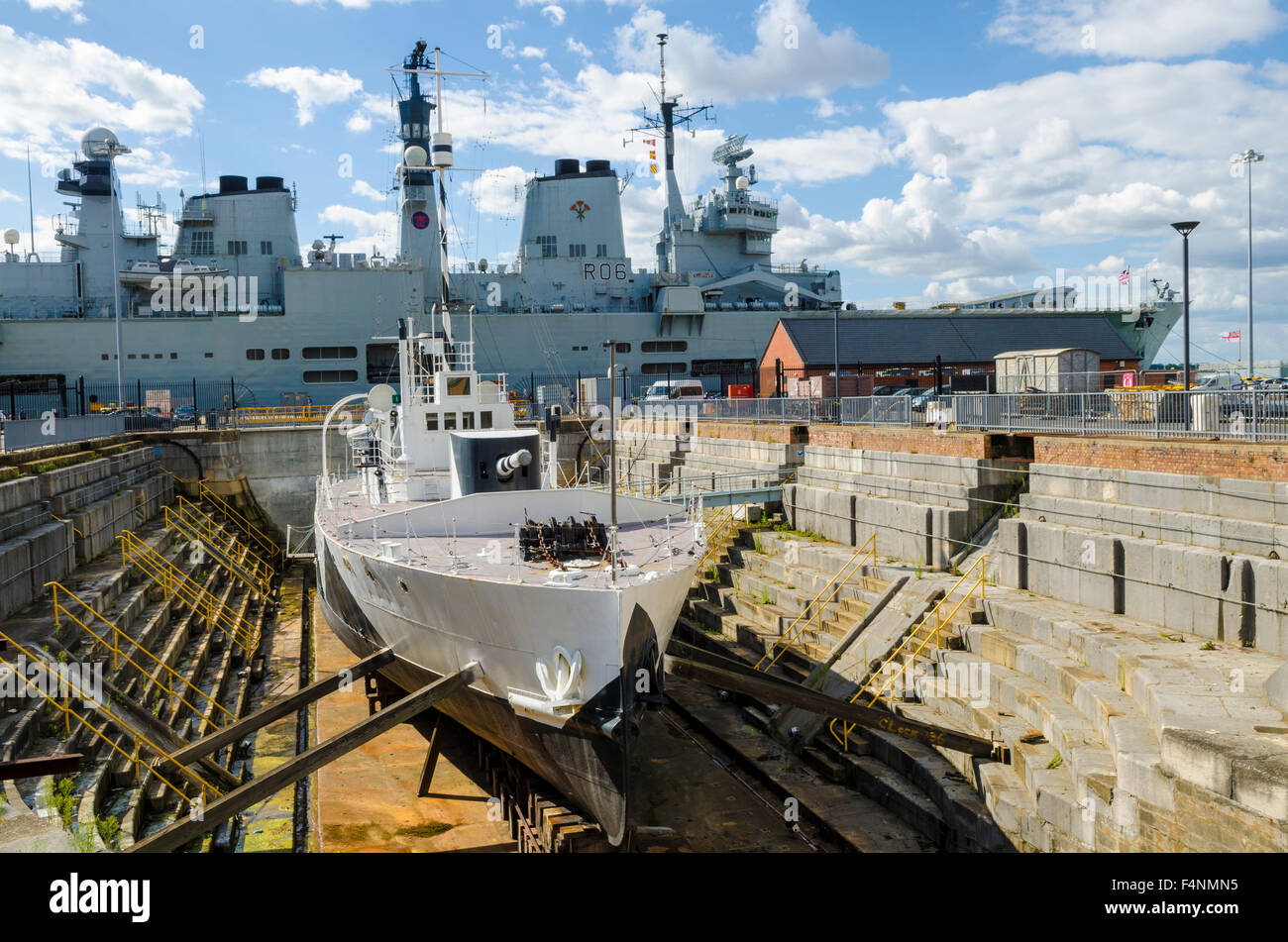 HMS M33 First World War Warship in dry dock at Portsmouth Historic Dockyard, Hampshire, England. - Stock Image