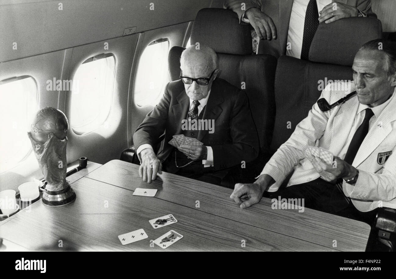 Italian President Sandro Pertini and CT of the National Football Enzo Bearzot playing cards on the plane returning - Stock Image