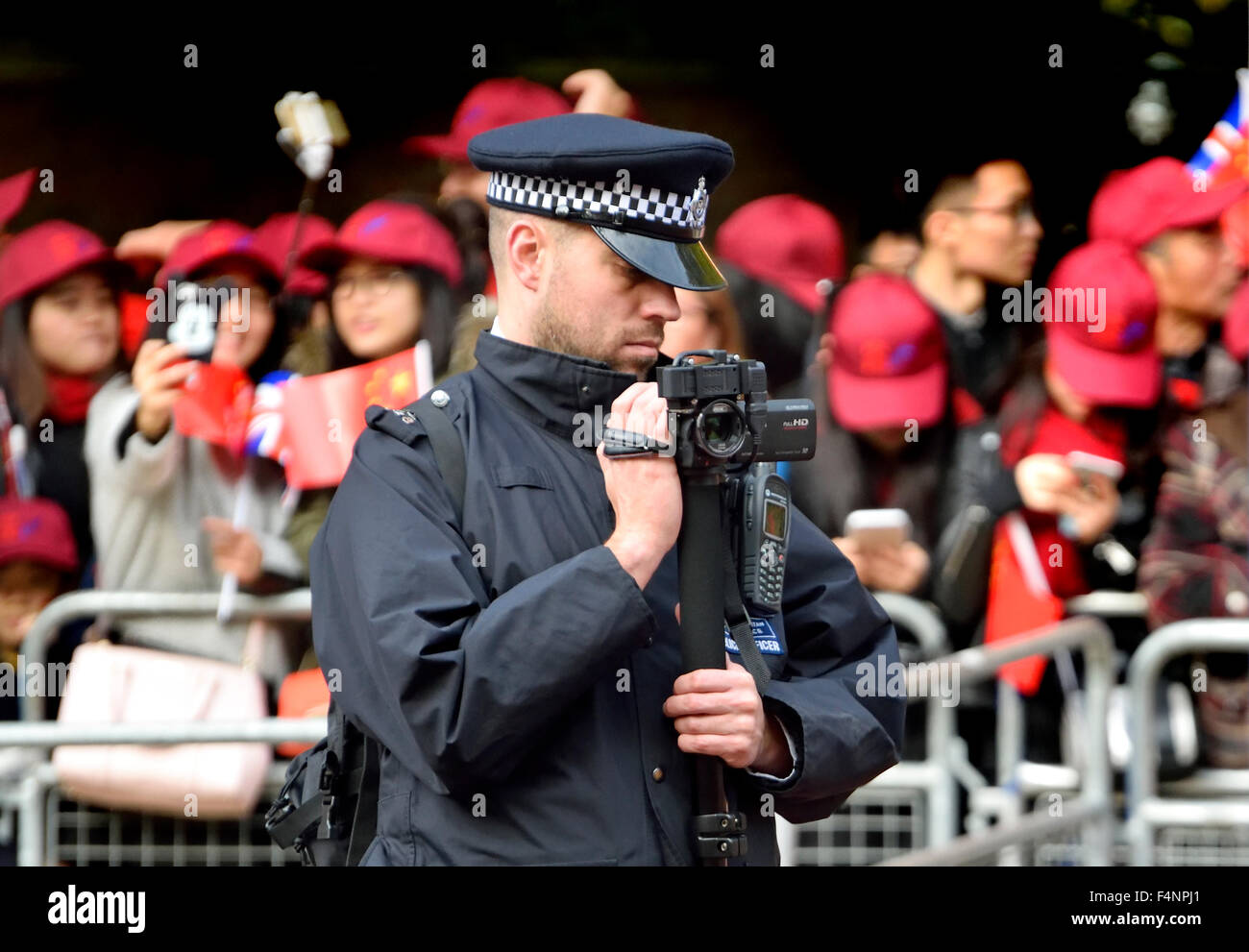 London Police Surveillance Stock Photos Headquarters 7744 2015 Officer Filming The Crowds And Protesters During Chinese President Xi Jinpings Visit
