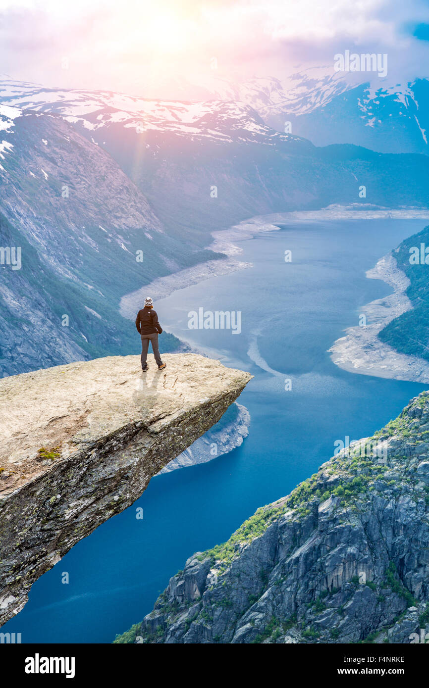 Woman On Trolltunga -  View On Norway Mountain Landscape From Trolltunga - The Troll's tongue in Odda, Ringedalsvatnet - Stock Image