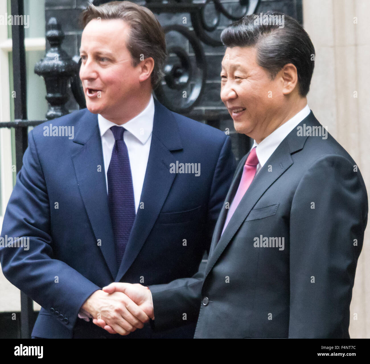 London, UK. October 21st 2015. British Prime Minister David Cameron greets Chinese President Xi Jinping  as he arrives - Stock Image