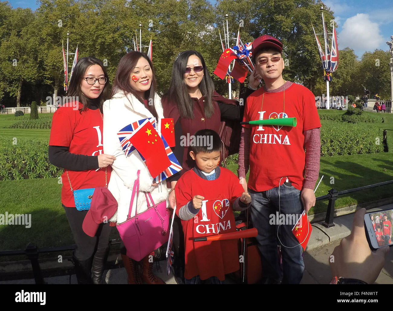 Pro Chinese supporter pose  for selfies on the  Mall after  the Chinese President Xi Jinping had gone  passed to - Stock Image