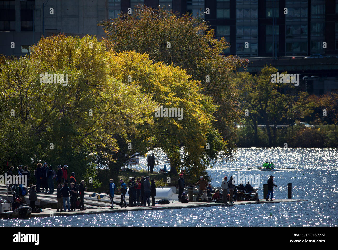 Fall foliage on the Charles River in Cambridge Massachusetts during the Head of the Charles Regatta. - Stock Image