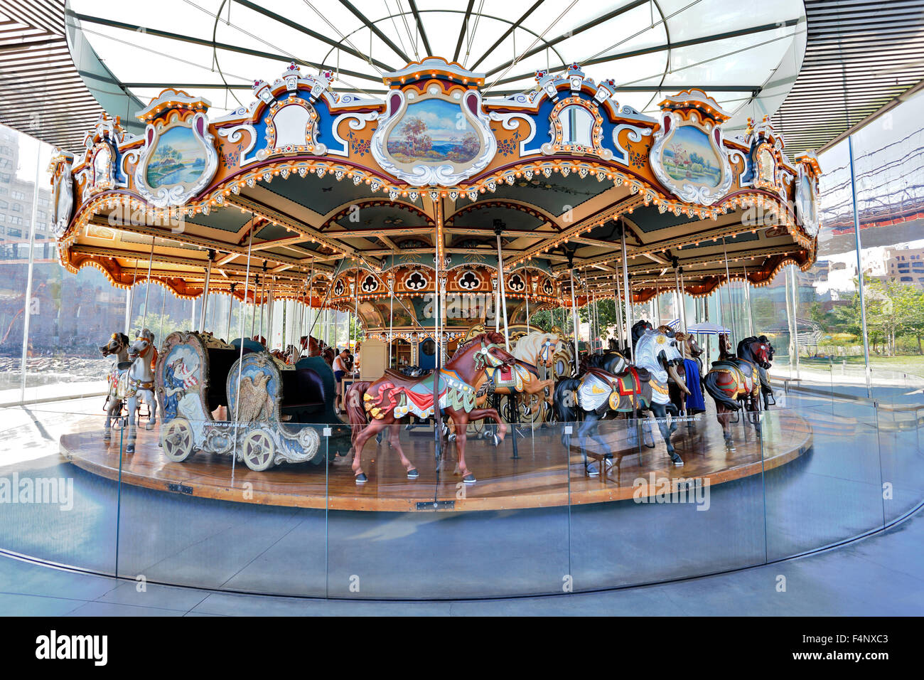 Jane's Carousel under the Brooklyn Bridge at Brooklyn Bridge Park Brooklyn New York City - Stock Image
