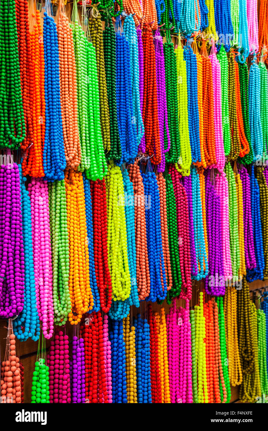 Strings of beads in the Khan el-Khalili souk in Cairo. - Stock Image