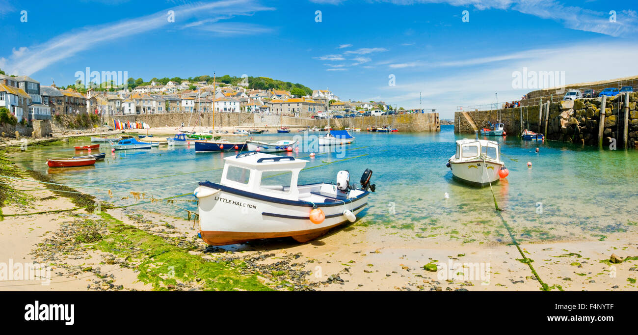 A 2 picture stitch panoramic view of the harbour at the fishing port and village of Mousehole in Cornwall. - Stock Image