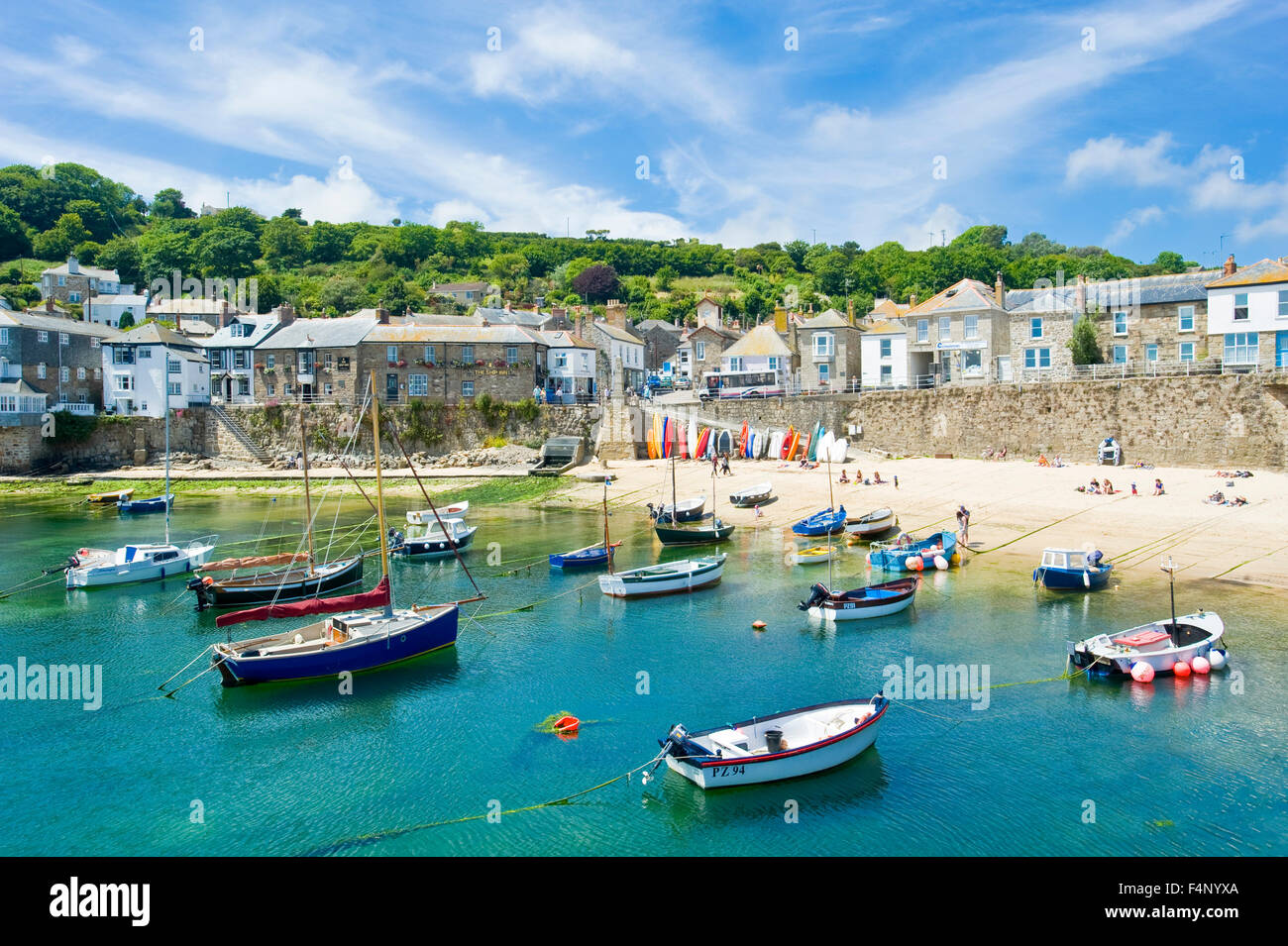 A view of the harbour in the quaint and picturesque fishing port and village of Mousehole in Cornwall. - Stock Image