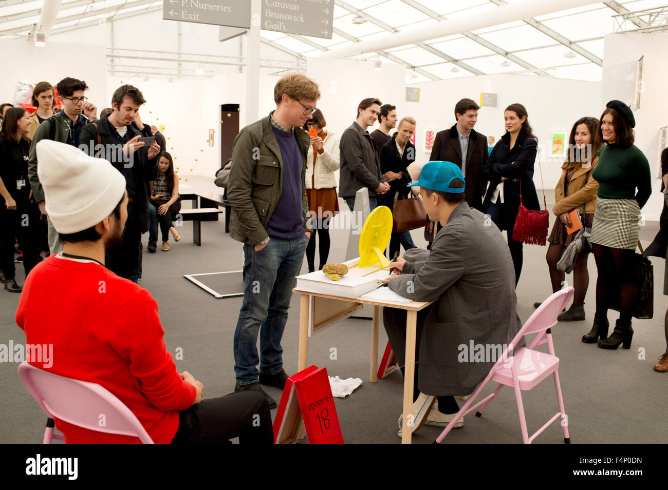 Freize Art Fair London. 2015. Stand of Ken Kagame who in 30 seconds draws visitors genitals for free. - Stock Image