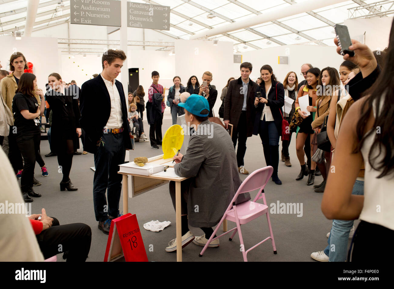 Frieze Art Fair London. 2015. Stand of Ken Kagame who in 30 seconds draws visitors genitals for free. - Stock Image