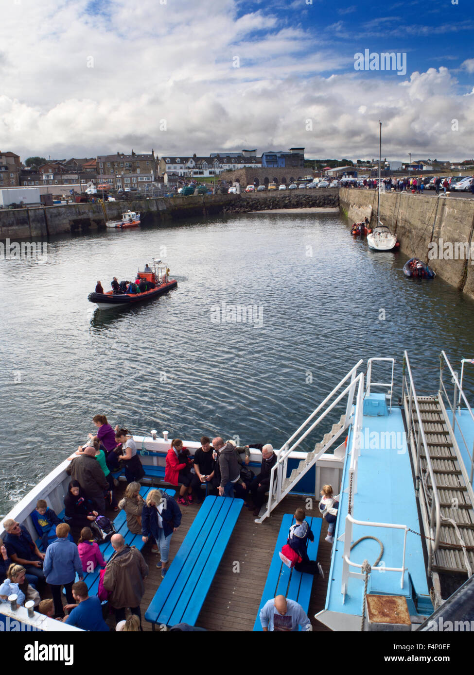 Boarding the Boat to the Farne Islands at Seahouses Northumberland England - Stock Image