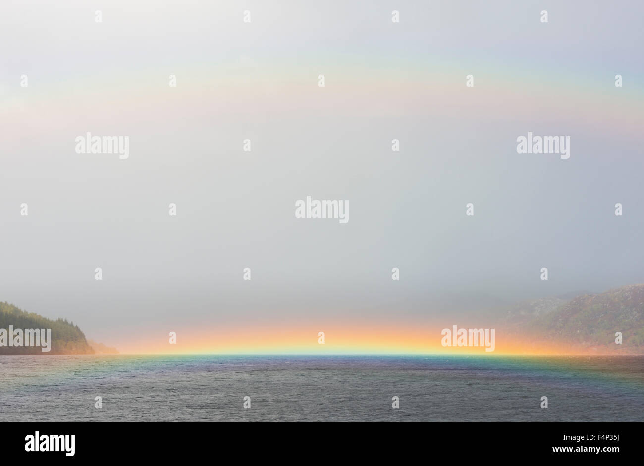 Rainbow on water on Loch Ness in Scotland - Stock Image