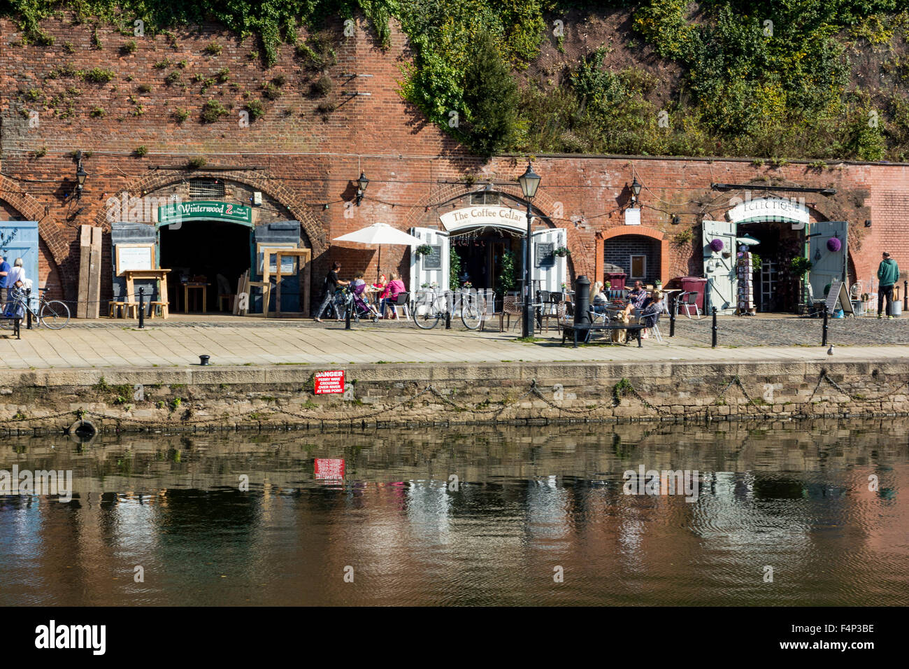 Historic Shops at The Old Cellars and River Exe Reflections, on a Sunny Autumn Afternoon, Exeter Quay, Devon. - Stock Image