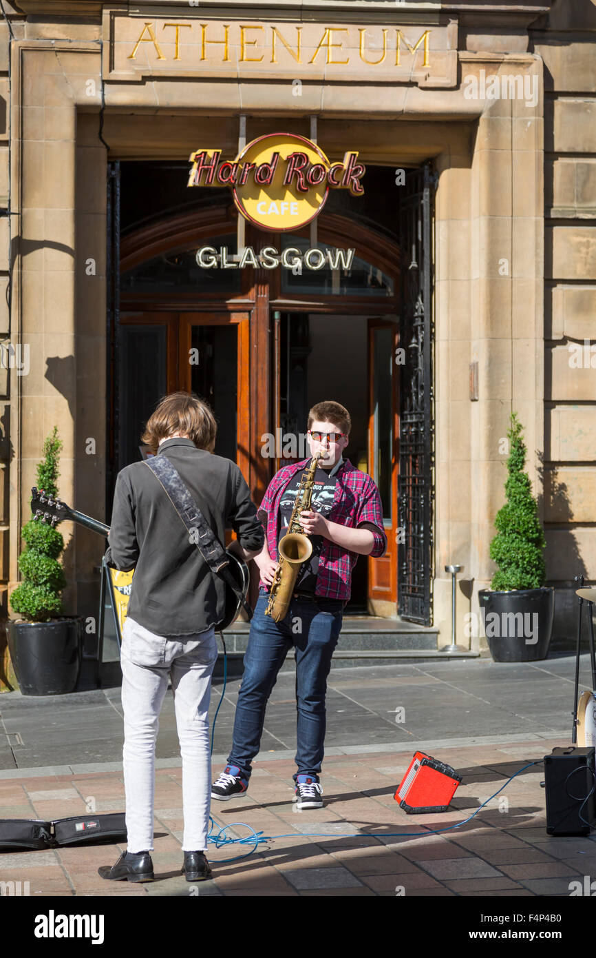 Two buskers playing on Buchanan Street in Glasgow city centre, Scotland, UK - Stock Image