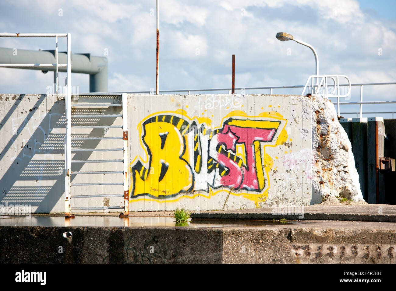 Graffiti on a concrete wall somewhere in netherlands stock image