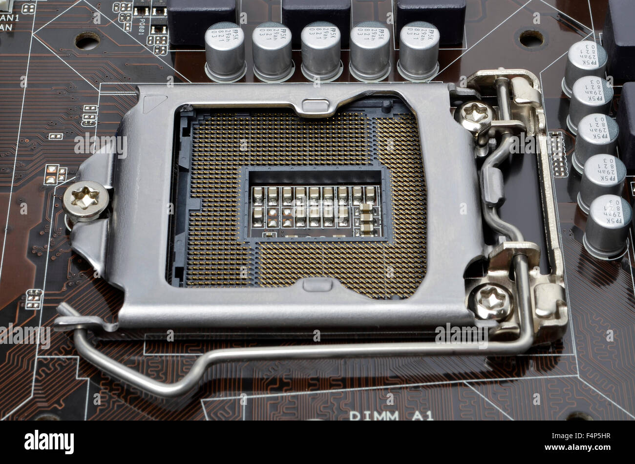 Intel LGA1155 processor socket on an ASUS motherboard. - Stock Image
