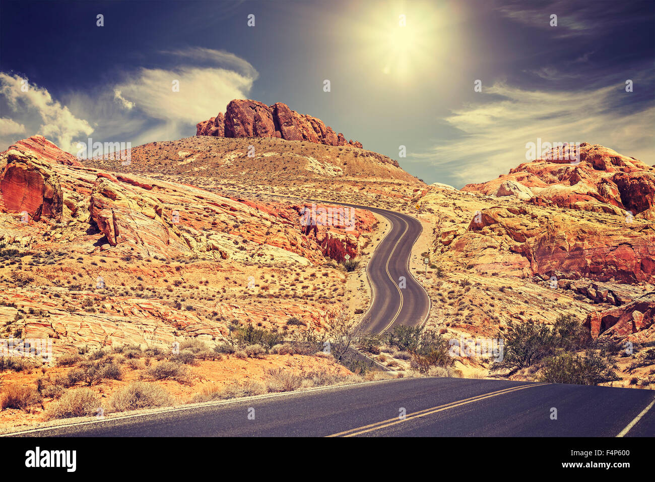 Retro stylized picture of a country road, travel concept, USA. - Stock Image