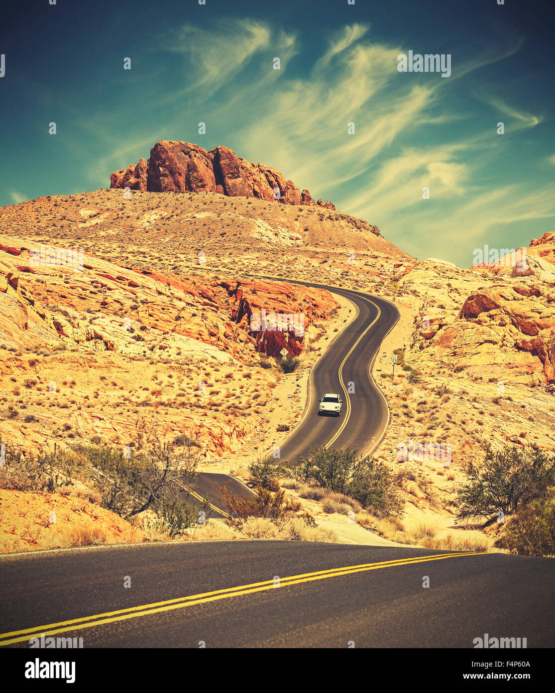 Retro toned winding desert highway, travel adventure concept, Valley of Fire State Park, Nevada, USA. - Stock Image