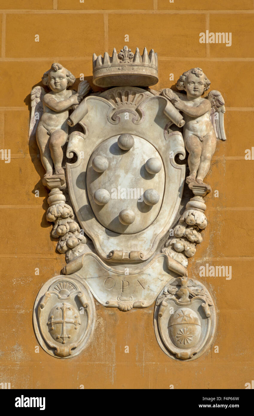 The Medici family embleme on a wall of Miracle's Place in Pisa - Stock Image