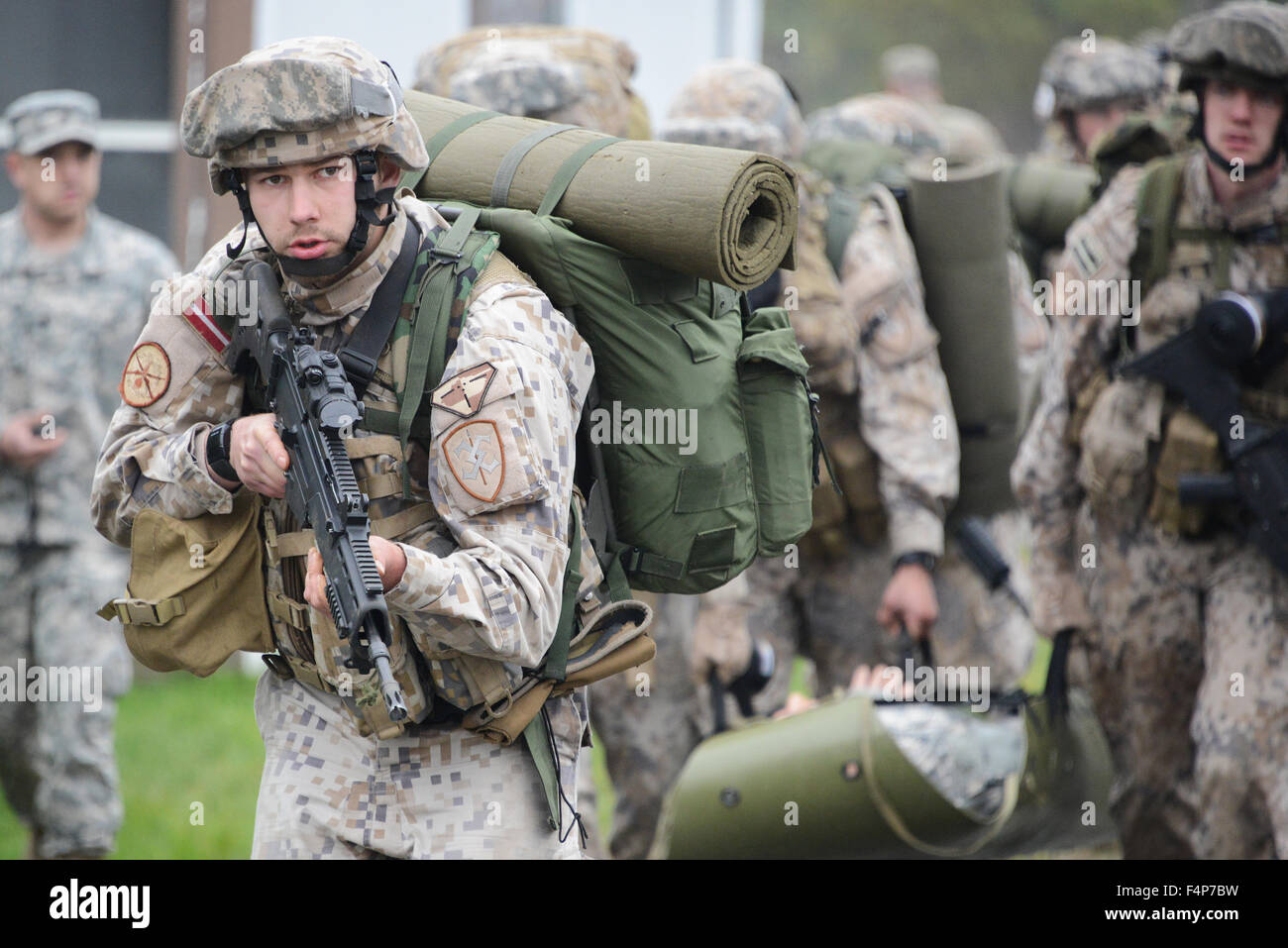 Latvian soldiers conduct the Urban Casualty Evacuation exercise during the European Best Squad Competition at the - Stock Image