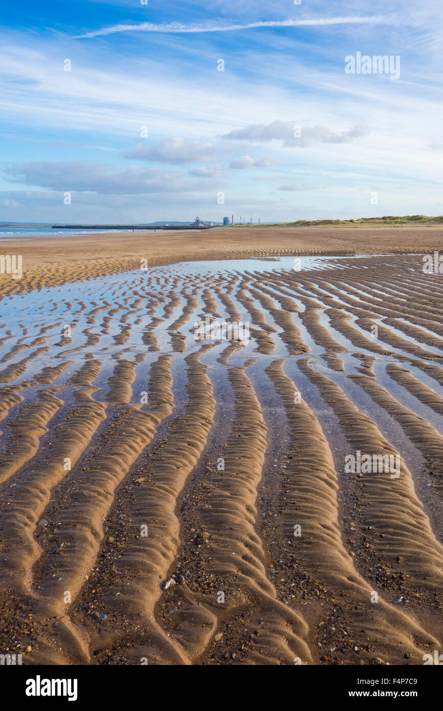Seaton Carew beach with Redcar steelworks in distance. Seaton Carew, north east England. UK Stock Photo