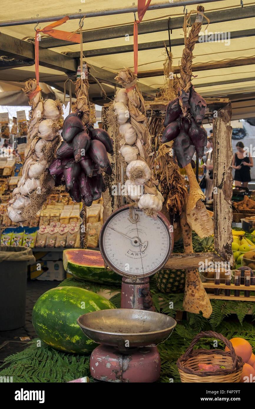 Old Brass Scales in use at Mercato Campo de' Fiori Market in Rome - Stock Image