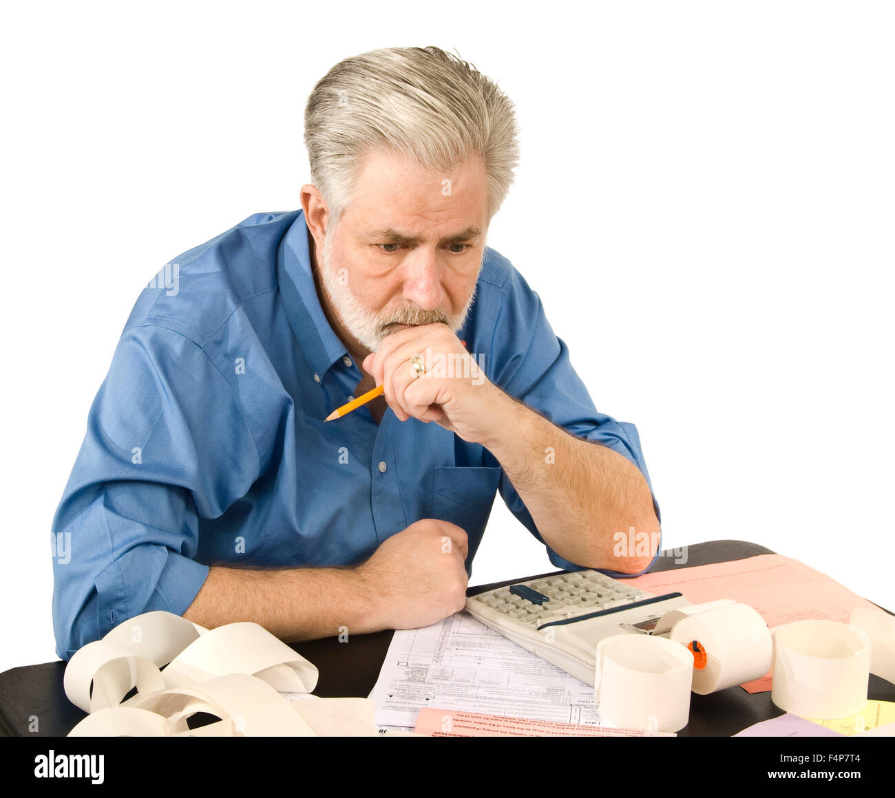 A middle aged man thinks about his tax worries - Stock Image
