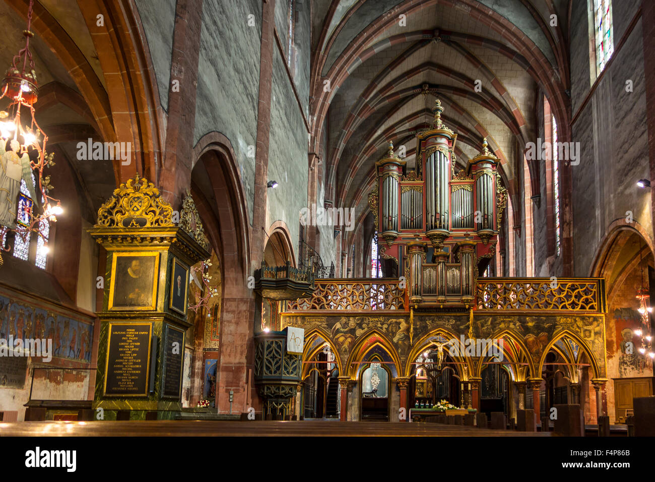 Choir screen  / rood screen and pipe organ of the Saint-Pierre-le-Jeune Protestant Church in Strasbourg, Alsace, Stock Photo