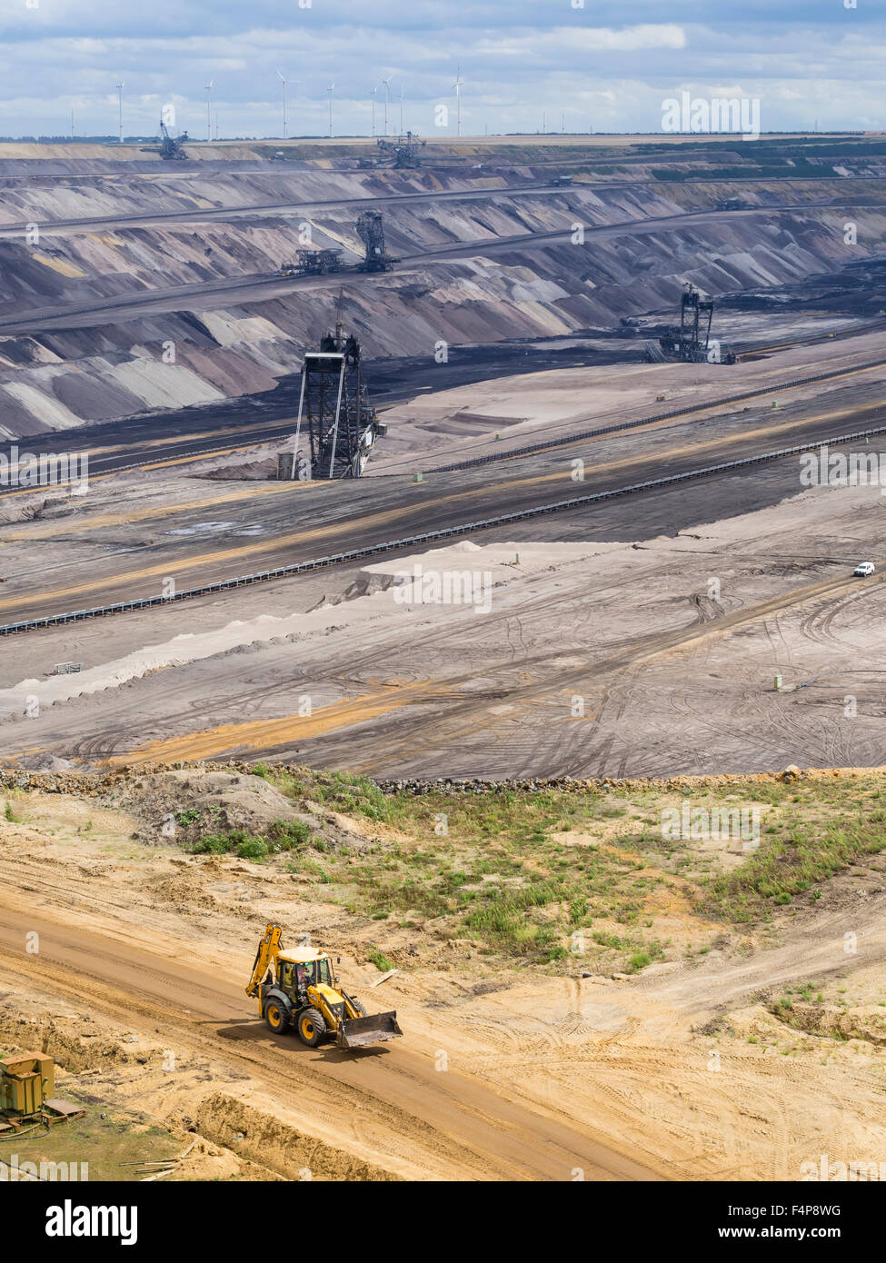 Bucket-wheel excavators in the cratered landscape of the surface mining field at Garzweiler, Germany's largest opencast Stock Photo