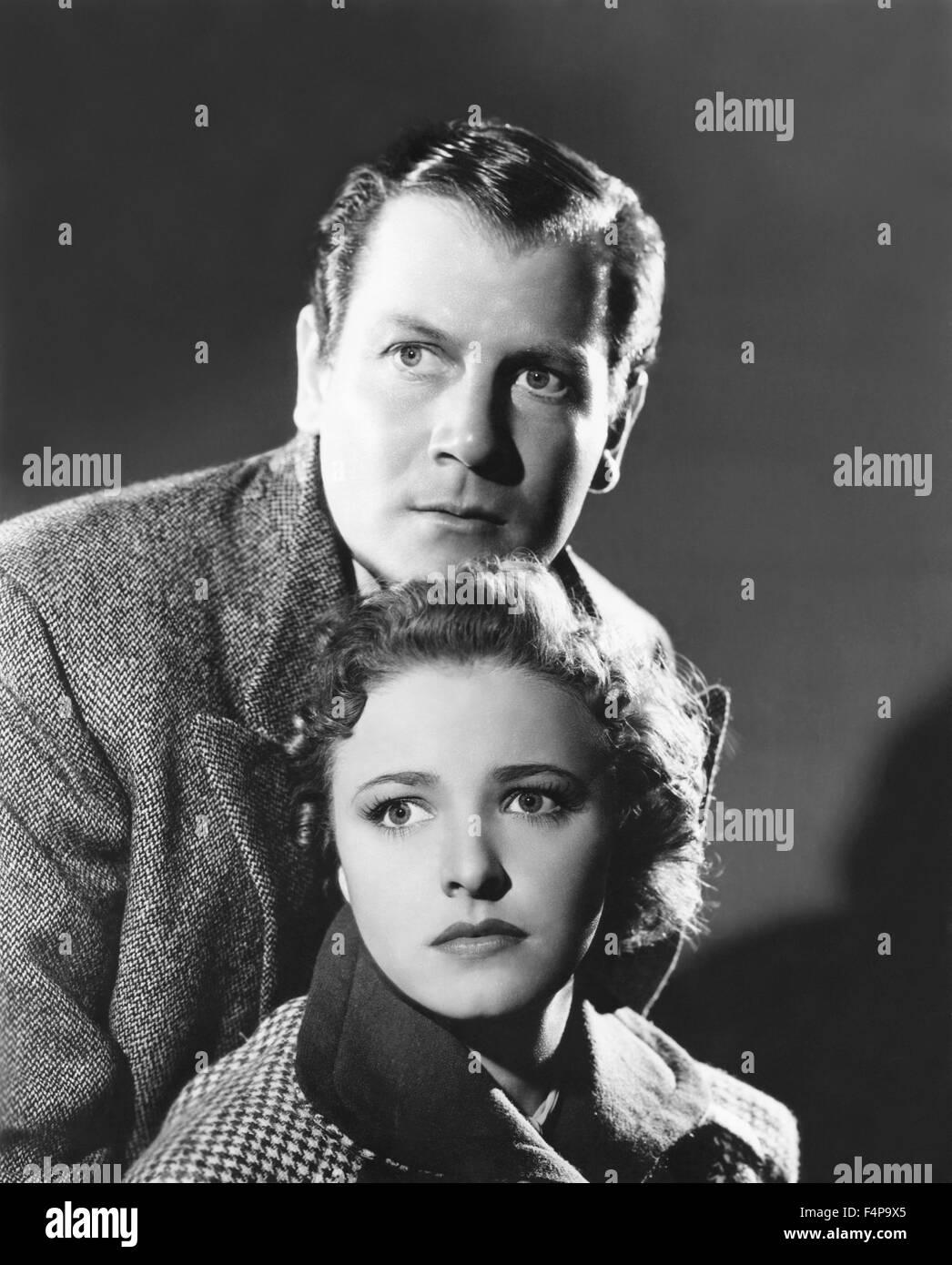 Joel Mc Crea, Laraine Dey / Foreign Correspondent 1940 directed by Alfred Hitchcock - Stock Image