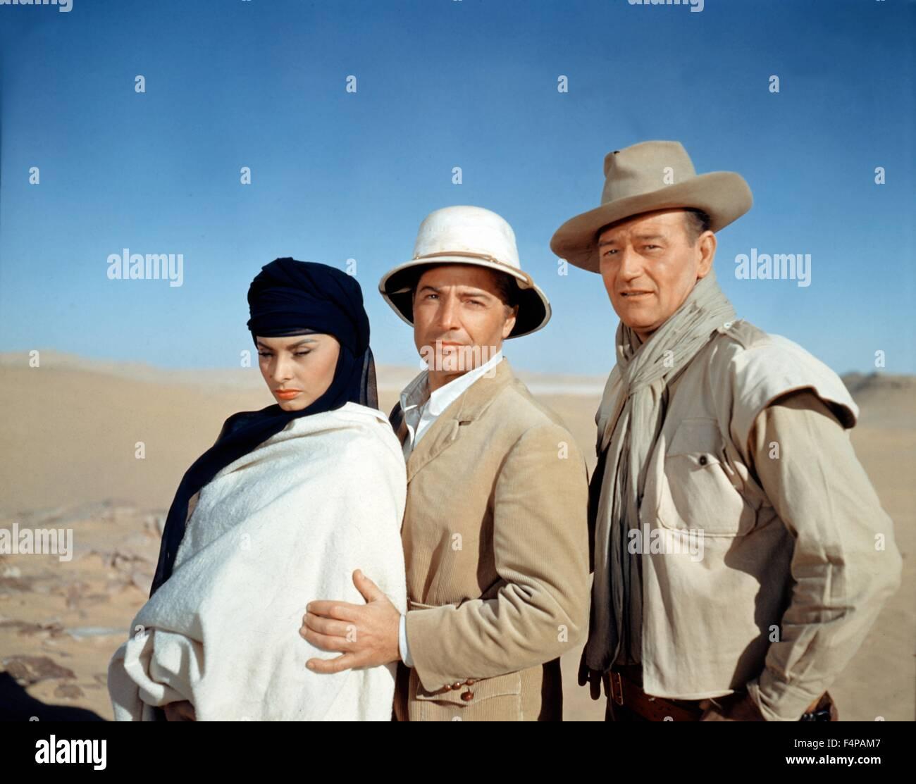 Sophia Loren, Rossano Brazzi, John Wayne / Legend of the Lost 1957 directed by Henry Hathaway - Stock Image