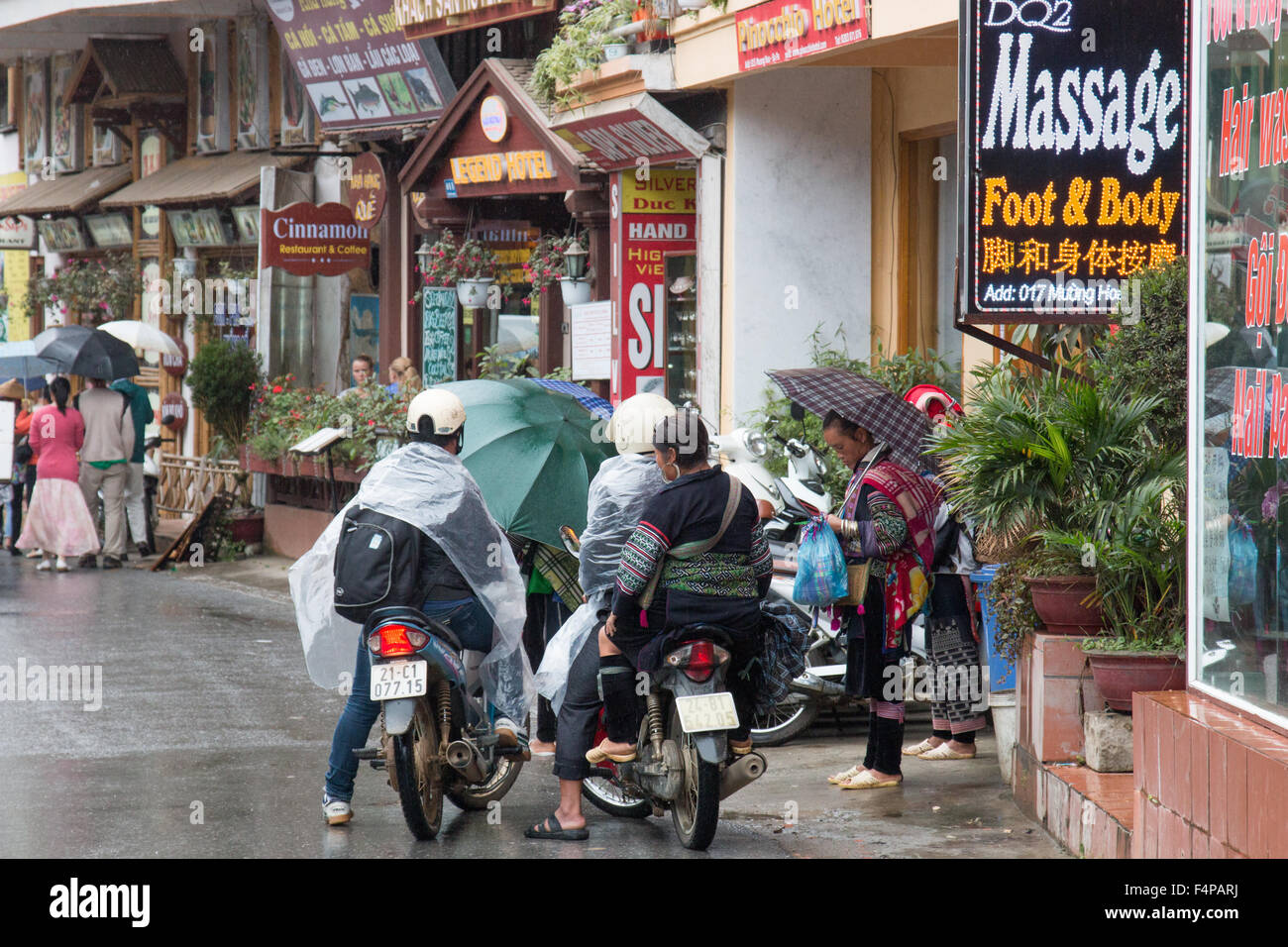 shops in Sapa town north west vietnam with people sheltering from the wet weather,Vietnam,Asia - Stock Image