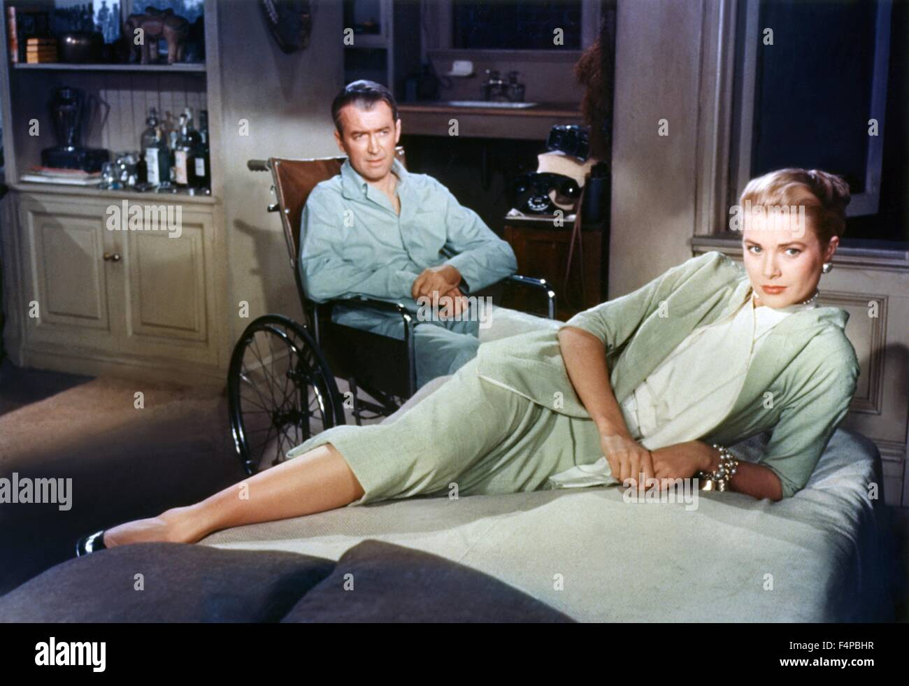 James Stewart, Grace Kelly / Rear Window 1954 directed by Alfred Hitchcock - Stock Image