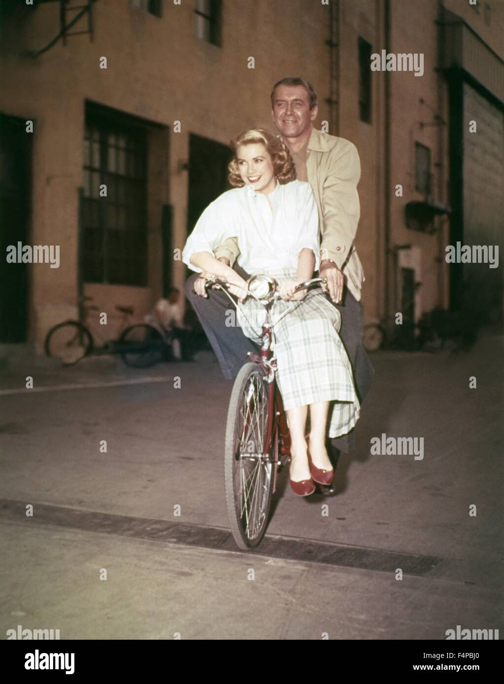Grace Kelly, James Stewart / Rear Window 1954 directed by Alfred Hitchcock - Stock Image