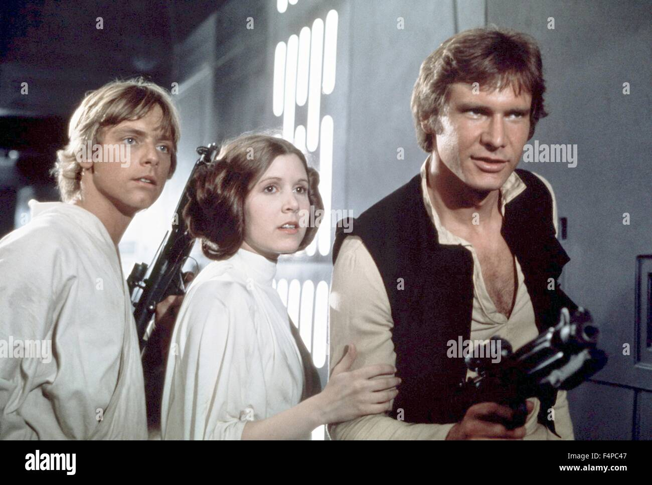 Mark Hamill, Carrie Fisher, Harrison Ford / Star Wars - A New Hope 1977 directed by George Lucas - Stock Image