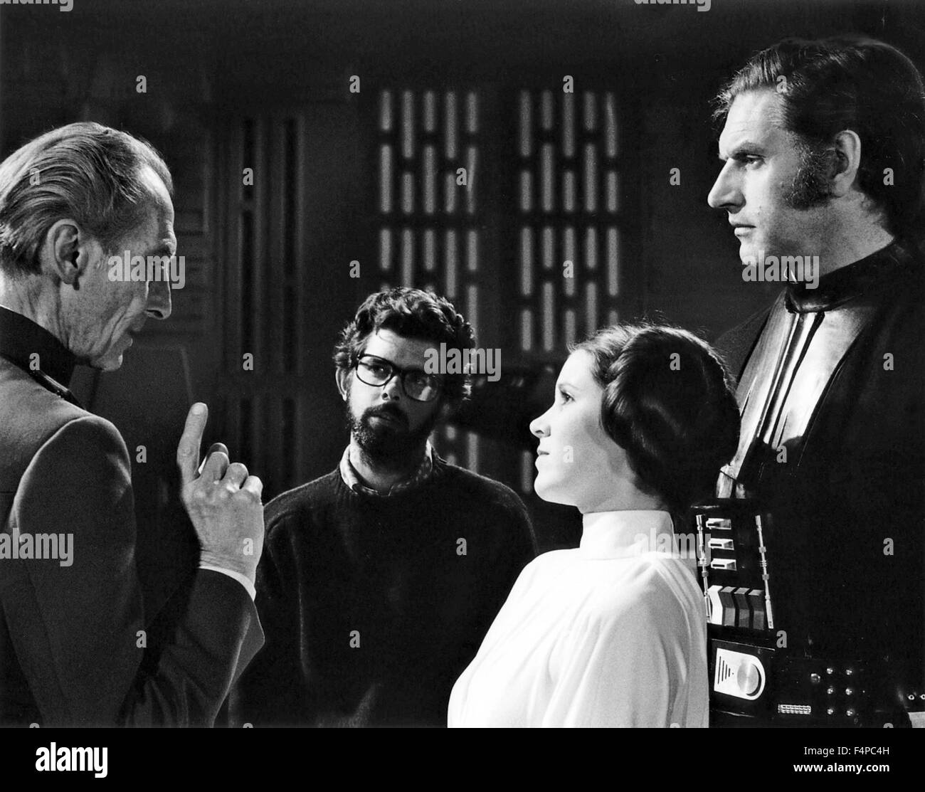 George lucas, Peter Cushing, Carrie Fisher, David Prowse / Star Wars - A New Hope 1977 directed by George Lucas - Stock Image
