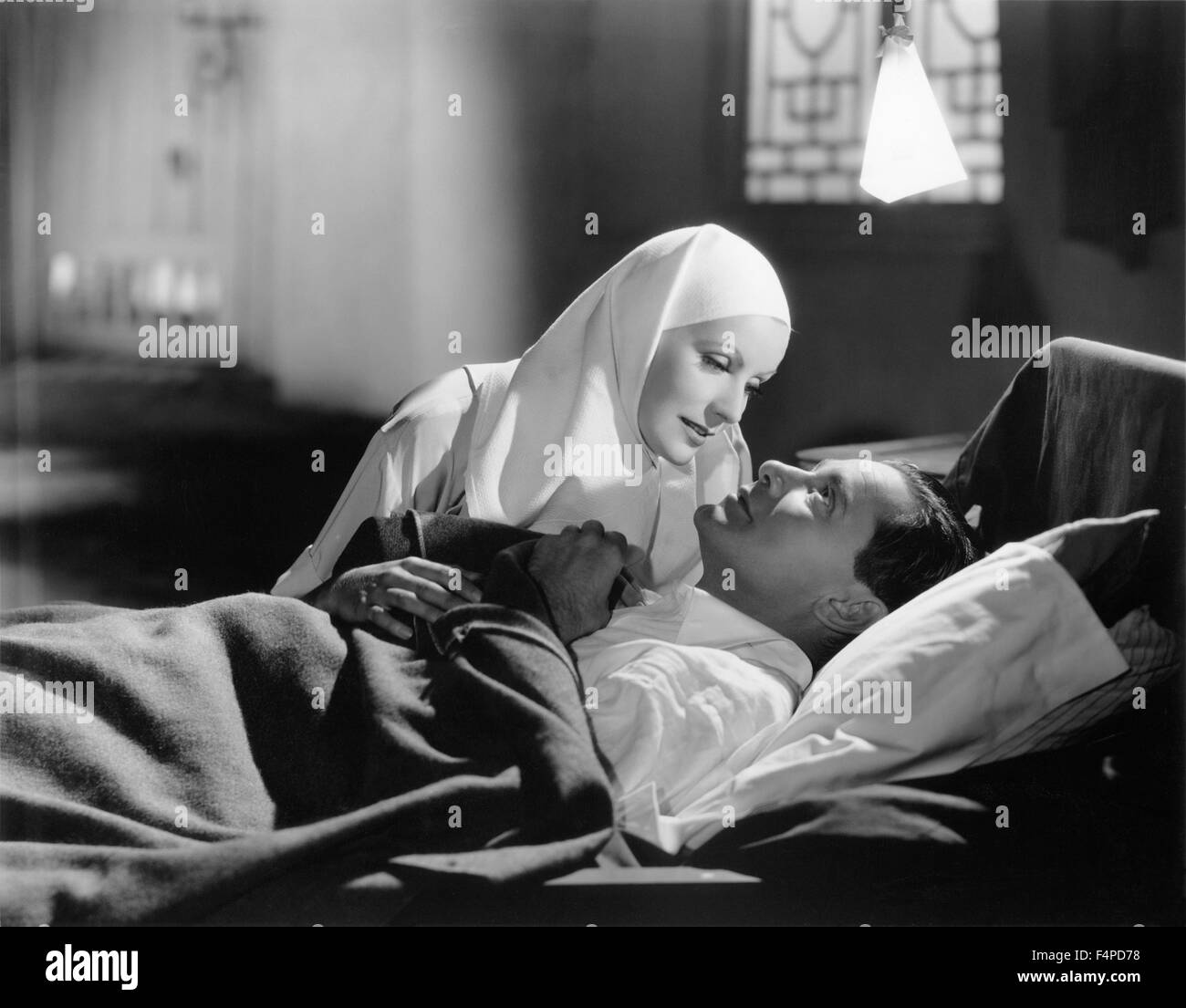 Greta Garbo, Herbert Marshall / The Painted Veil 1934 directed by Ryszard Bolesławski - Stock Image