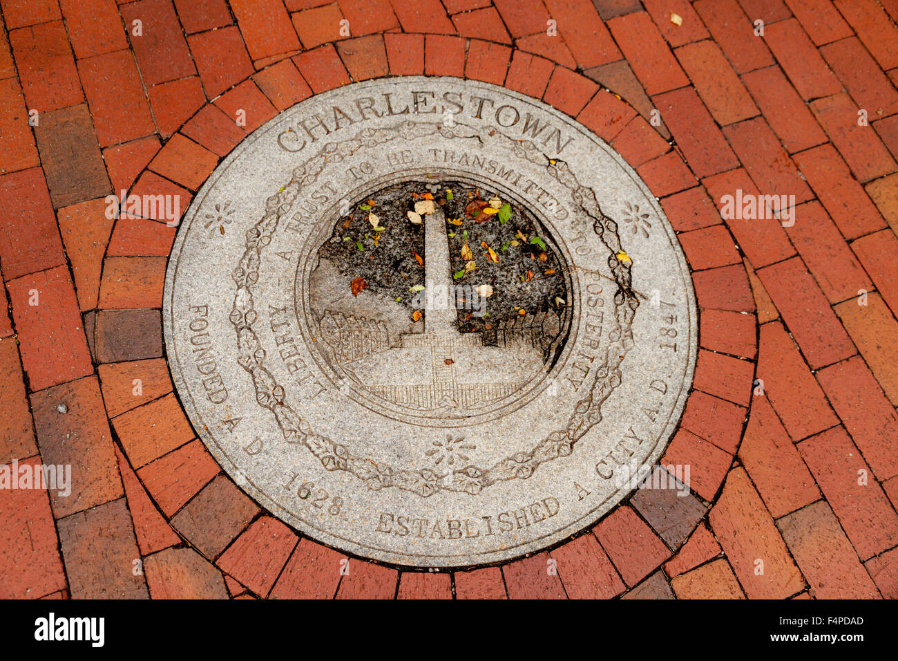 A commemorative marker in the ground in Charlestown neighborhood, Boston Massachusetts USA - Stock Image