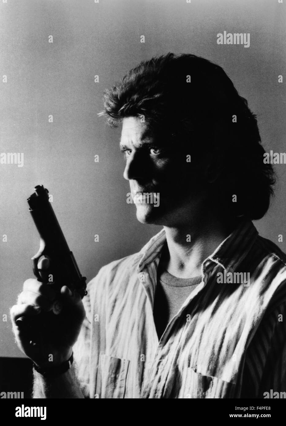 Mel Gibson / Lethal Weapon / 1987 directed by Richard Donner - Stock Image