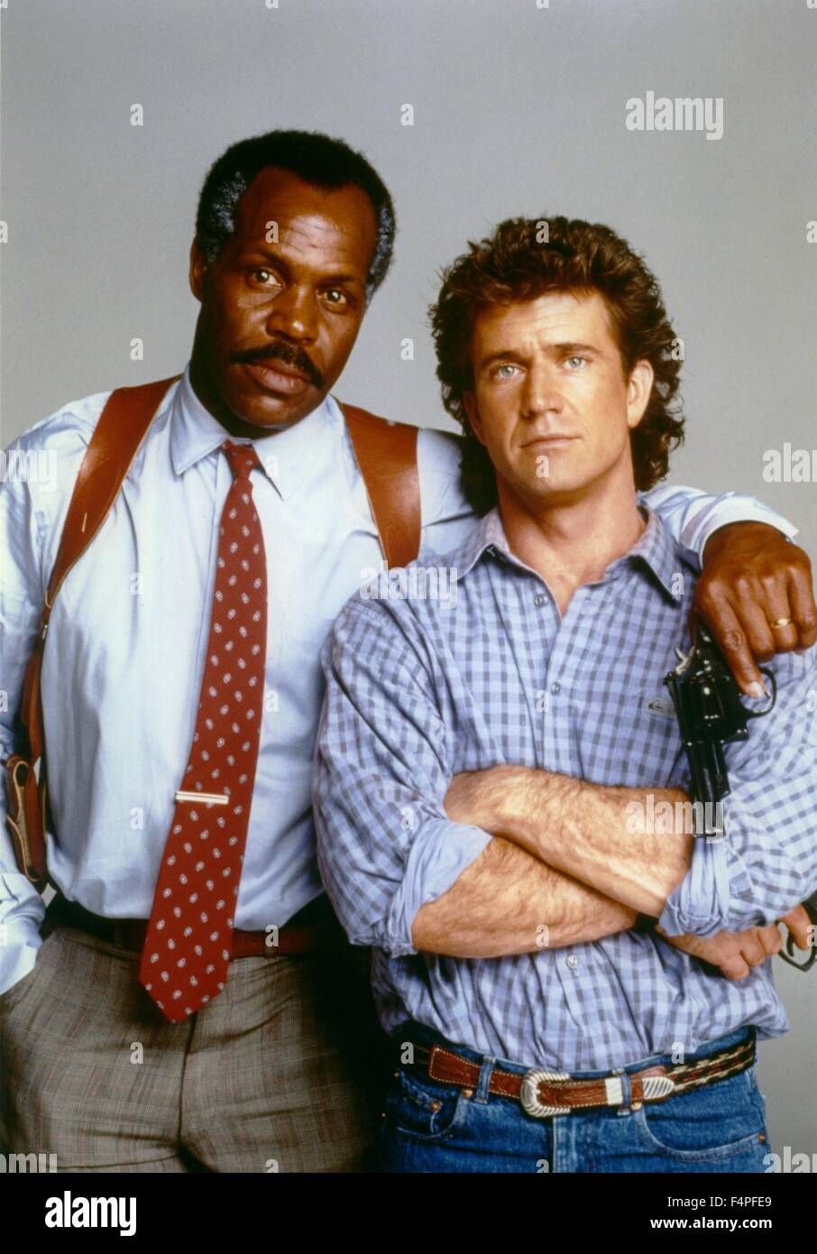 Danny Glover and Mel Gibson / Lethal Weapon / 1987 directed by Richard Donner - Stock Image