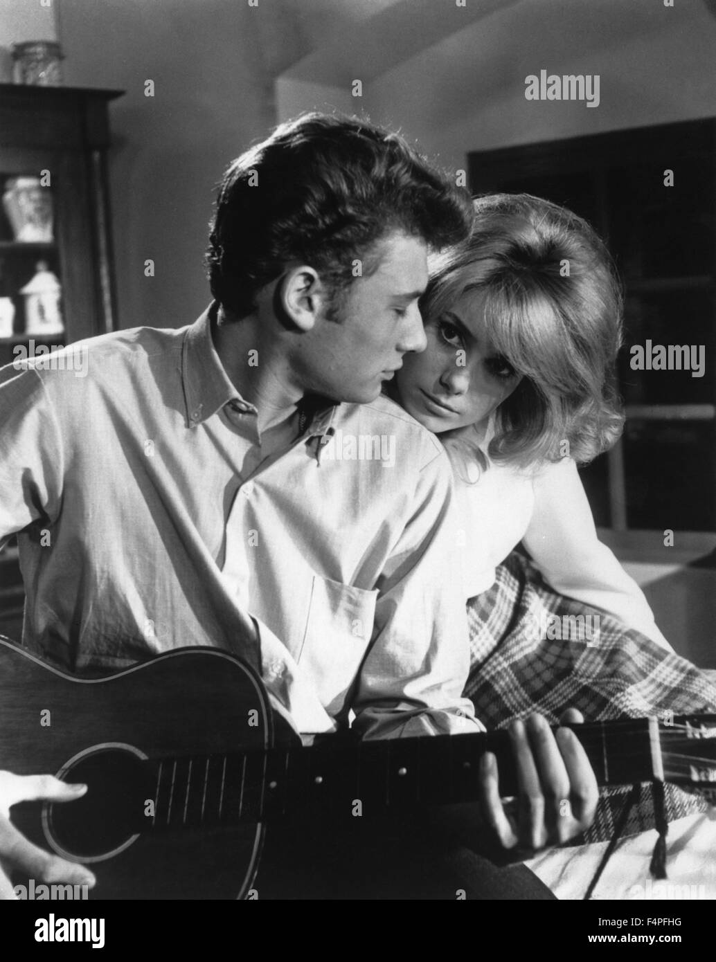 Johnny Hallyday and Catherine Deneuve / Beds and Broads / 1961 directed by Marc Allegret and Michel Boisrond - Stock Image