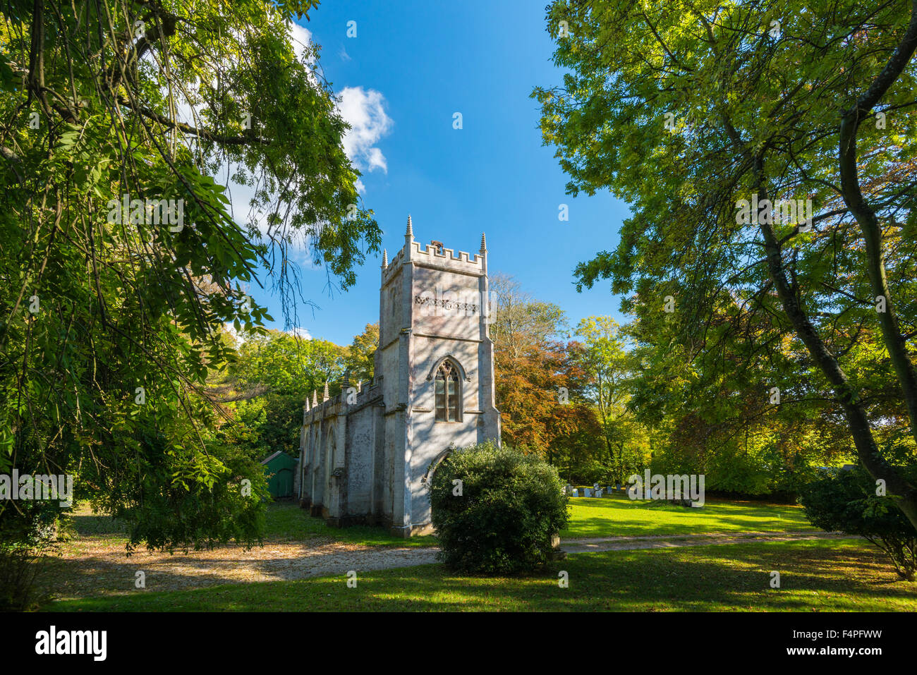 Autumn colour surrounds the Church of the Holy Trinity at Fleet in Dorset, UK near Weymouth - Stock Image
