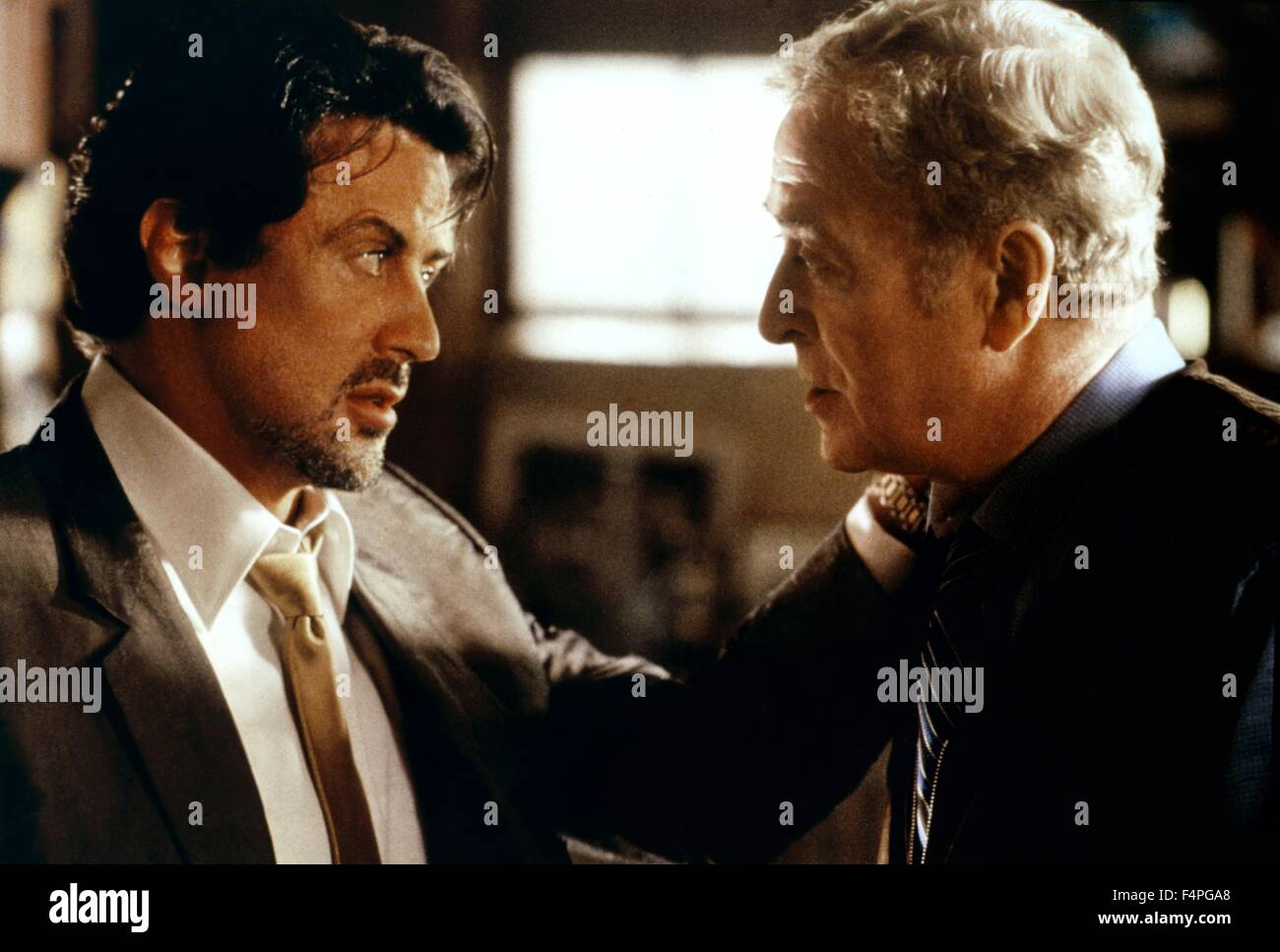 Sylvester Stallone and Michael Caine / Get Carter / 2000 directed by Stephen Kay - Stock Image