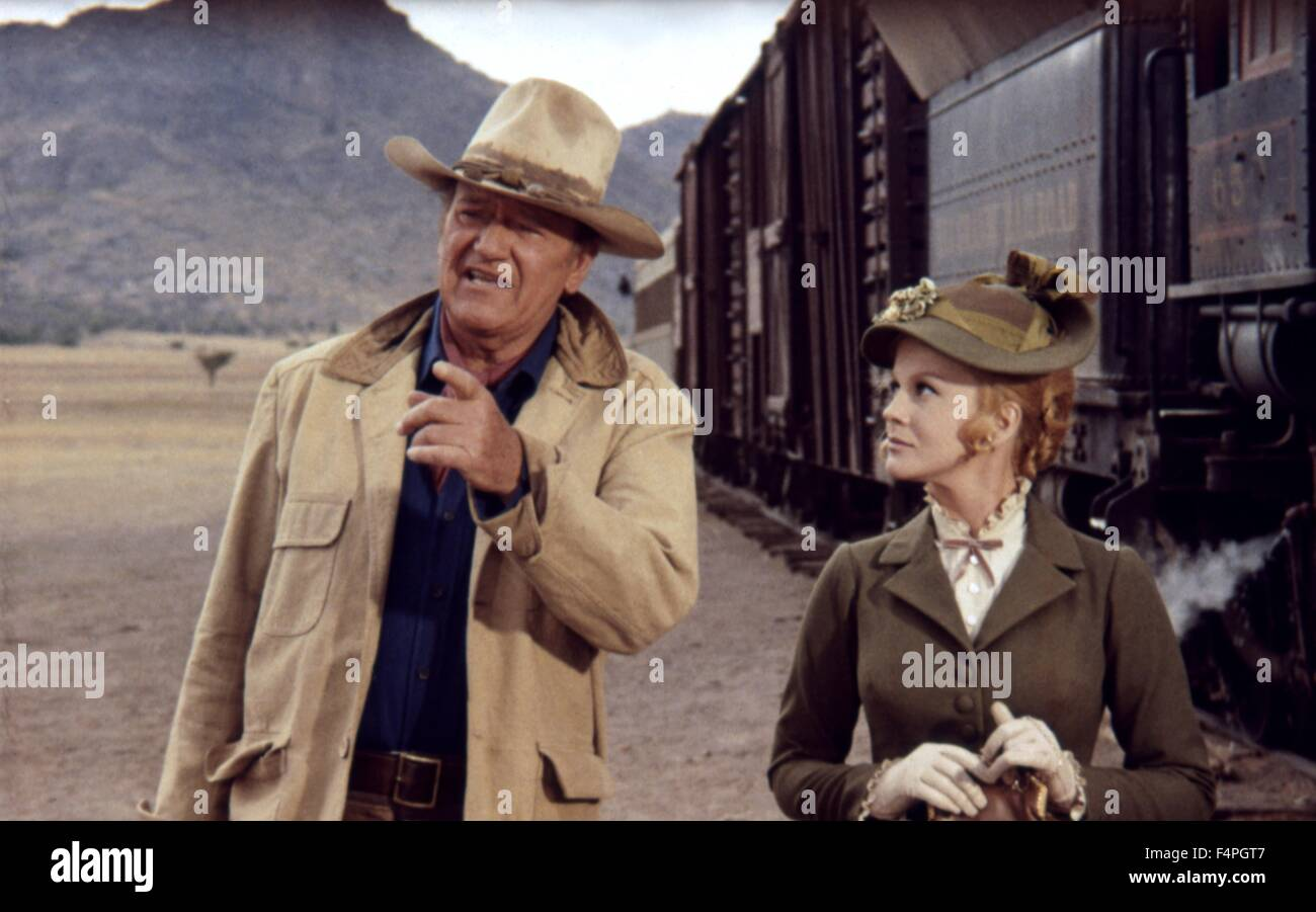 John Wayne and Ann-Margret / The Train Robbers / 1973 directed by Burt Kennedy - Stock Image